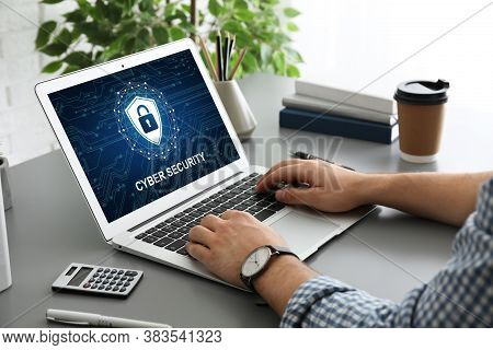 Cyber Security Concept. Man Using Application On Laptop, Closeup