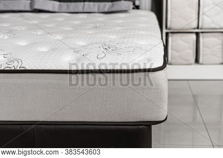 Choosing Mattress. Close-up White Mattress In Furniture Store. Copy Space.