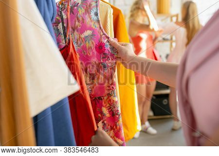 Wear, Clothing Shop During Sales, Summer Or Autumn Collection. Close Up Hands Trying Cloth, Looking
