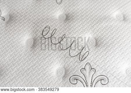 Metal Spring On A White Mattress. The Concept Of Filling A Mattress. Technology Concept