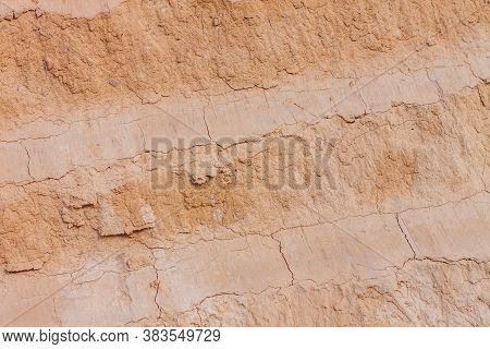 Background Of Great Clay Wall Or Brown Ocher. Grunge Rock Texture Cracked Ground Texture In Vintage