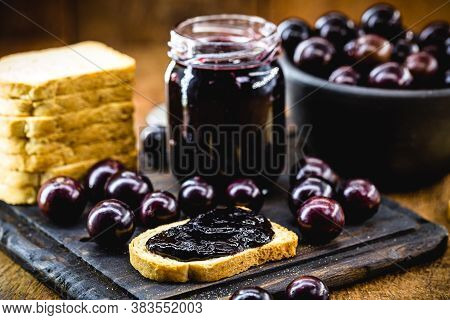 Toast With Grape Jam, On Rustic Wooden Table. Jabuticaba, Exotic Brazilian Fruit, Used In Cooking, A