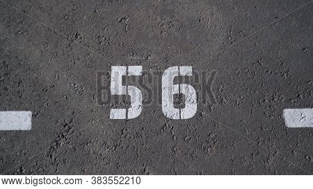 Close-up Of A White Paint Number Marking In A Parking Lot. Empty Parking Lot, Parking Lot With White