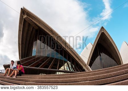 Sydney, Australia - January 12, 2009: People Sitting On The Steps Near The Sydney Opera House In Syd