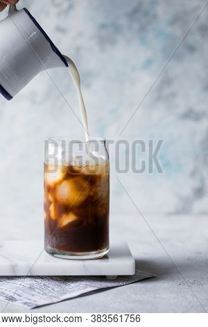 Frappe Milk Shake Coffee In Tall Glass On Blue Background.frappe Milk Shake Coffee