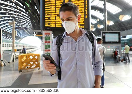 Young Business Man Wearing Kn95 Ffp2 Face Mask At Train Station. Young Caucasian Man With Behind Tim