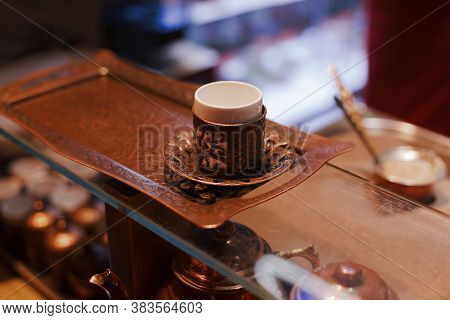 Tiny Ceramic Cup For Turkish Coffee In Brass Coaster Close Up, Traditional Turkish Tableware
