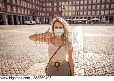 Attractive Happy Young Tourist Woman With Face Mask In Europe. Covid-19 New Normal And Tourism
