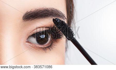 Close Up Beside Applying Mascara Brush On Eyelash. Applying Cosmetic Make Up Eyelash Extensions. Asi