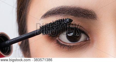 Close Up Applying Mascara Brush On Eyelash. Applying Cosmetic Make Up Eyelash Extensions. Asian Eye