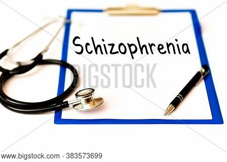 Schizophrenia And Psychotic Concept Schizophrenia Tex On A Doctor's Paper Holder Next To A Pen Steth