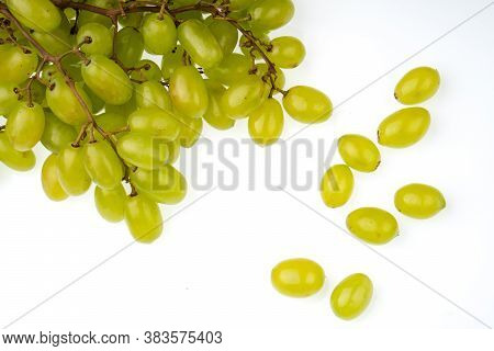 A Bunch Of Table Grapes On A White Background And A Bunch Of White Grapes Scattered On A White Backg