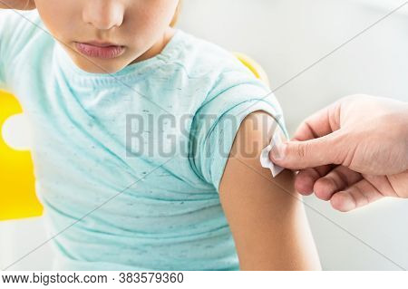 Little Girl In The Doctor's Office Is Vaccinated. Syringe With Vaccine Against Covid-19 Coronavirus,