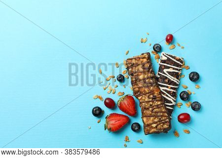 Tasty Granola Bars On Blue Background, Top View