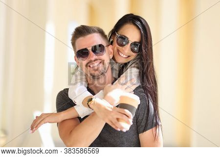 Woman And Man In Sunglasses Are Smiling And Hugging. Mutual Understanding And Happiness In Relations