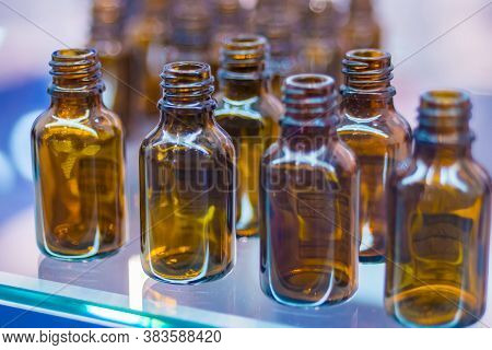 Close Up View - Medical Empty Glass Brown Bottles In Showcase At Pharmaceutical Exhibition, Pharmacy