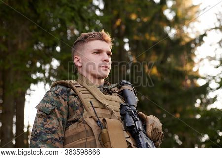 soldier portrait with  protective army tactical gear  against old brick wall