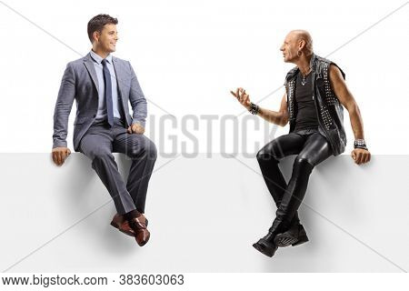 Punk talking to a professional man seated on a blank panel isolated on white background