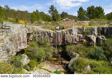 Couple Waving Hand On Top Of A Beautiful Amazing Waterfall Drone Aerial View Of Landscape In Vila De