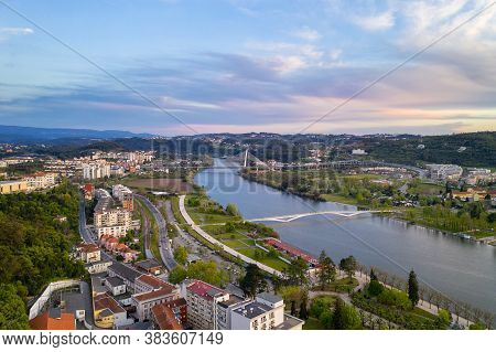 Coimbra Drone Aerial View Of The City Park, Buildings And Bridges At Sunset, In Portugal