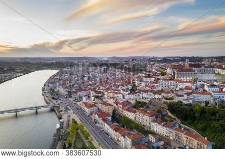 Coimbra Drone Aerial City View At Sunset With Mondego River And Beautiful Historic Buildings, In Por
