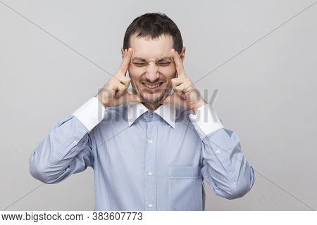 Headache Pain. Portrait Of Angry Bristle Businessman In Classic Blue Shirt Standing Holding His Pain