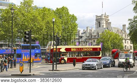 London, Great Britain -may 22, 2016: Tourist Double Decker Buses In Central London, In The Backgroun