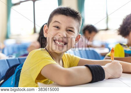 Naughty School Boy Looking The Camrea In Classroom