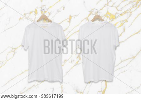 White Blank Front And Back T-shirt On White Marble Wall Background.