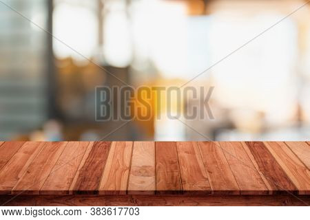 Empty Top Of Wood Table With Blur Cafe Or Coffee Shop Background.