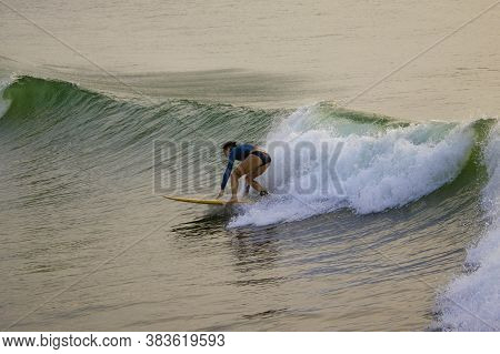 Chennai, Tamilnadu -india . September 2, 2020. A Foreign Lady Tourists Surfing The Sea Waves, Young