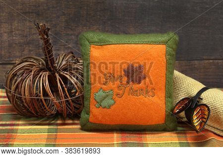 Fall Table Centerpiece For Thanksgiving Including A Wicker Pumpkin, Napkin With Ring And Mini Give T