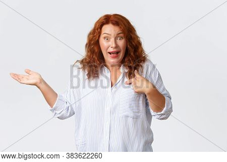 Confused And Surprised Middle-aged Woman React To Nonsense Accusations, Pointing At Herself And Rais
