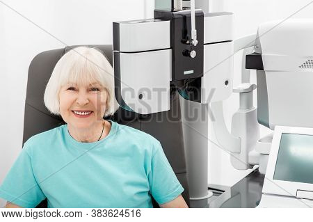 Checking Smiling Elderly Womans Eyesight On The Modern Phoropter. If A Woman Has Poor Eyesight, The