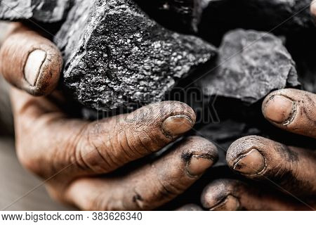 Miner Dirty Hands Holding Piece Of Fossil Lignite Coal Mine