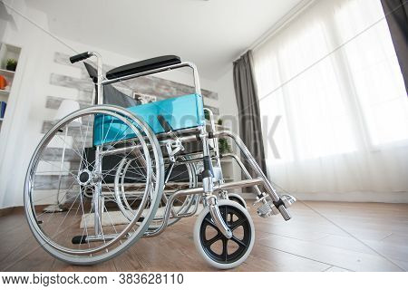 Wheelchair In Recovery Room Of Nursing Facility For Handicapped People. No Patient In The Room In Th