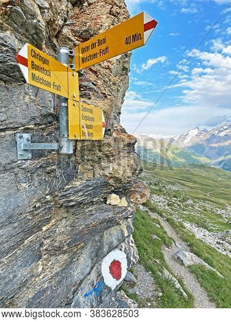 Mountaineering Signposts And Markings On The Slopes Of The Melchtal Alpine Valley And In The Uri Alp