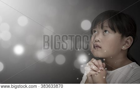 Asian Face Child Praying And Worship To God Using Hands To Pray In Religious Beliefs And Worship Chr