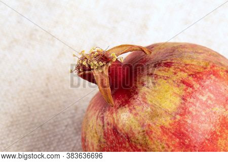 Close-up Of Ripe Delicious Pomegranate On Light Background