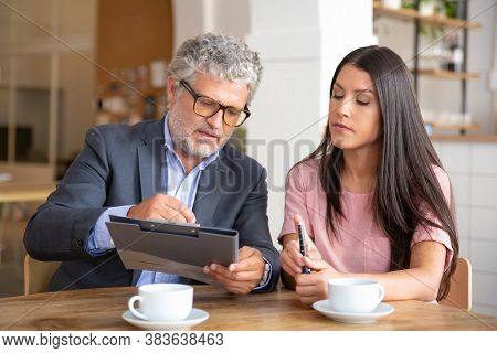 Confident Paper Expert Reading, Analyzing And Explaining Document To Female Customer. Man And Woman