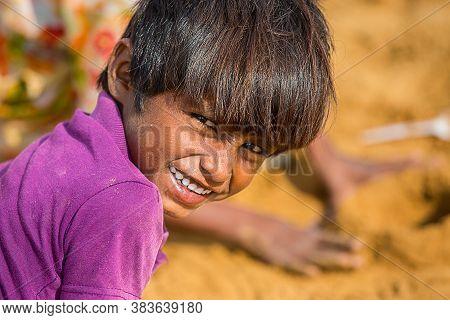 Jodhpur, Rajasthan, India - June 18th, 2019: Closeup Poor Rural Boy Kid Smiling Towards Camera, Pove