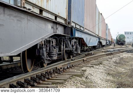 Freight Cars With A Wheelset Node Close-up Going Into The Distance With The Tanks Of Another Train I
