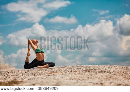 Woman Stretching On Mountain. Pilates, Yoga Or Contemplation. Comfy Sportswear For Workout. Breathta