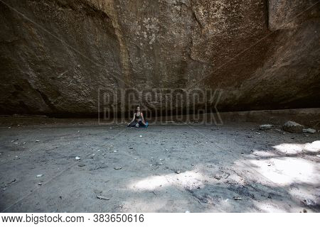 Woman Sitting On Ground In Mountains. Deep Meditative State Inside Meditation. Contemplation Or Yoga