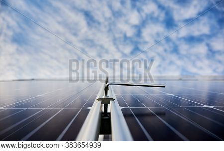 New Solar Module With Beautiful Blue Sky On Blurred Background. Solar Power System For Generating El