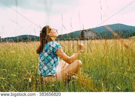 Beautiful Woman Relaxing In Nature. Happy People Lifestyle. Woman Relaxing In Meadow. Nature Lifesty