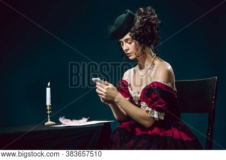 Secret Chat. Young Woman As Anna Karenina Isolated On Dark Blue Background. Retro Style, Comparison