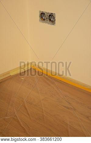 Oak Floor Covered With Transparent Plastic Film