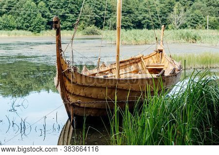 Old Wooden Viking Boat By The Lake On Sunny Summer Day