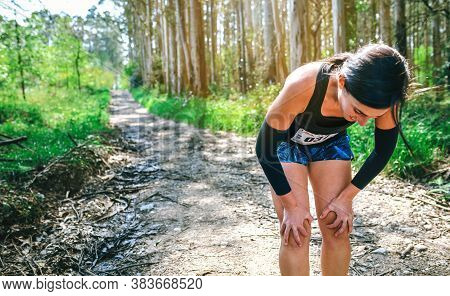 Tired Young Female Athlete Pausing At A Trail Competition
